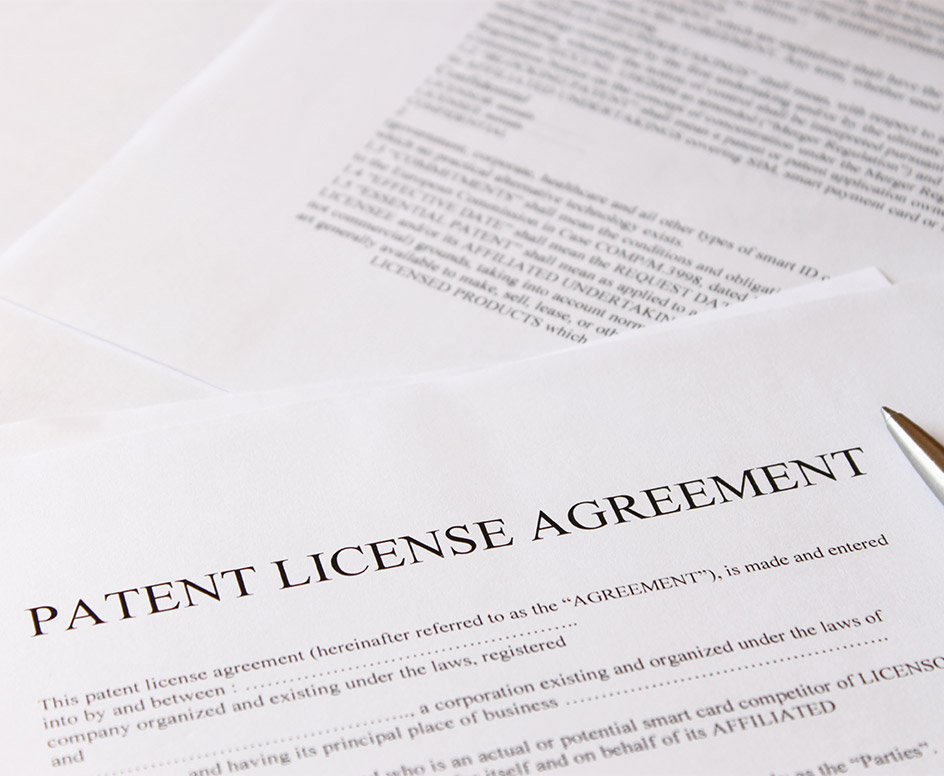 "Pen and paper titled ""Patent License Agreement"""