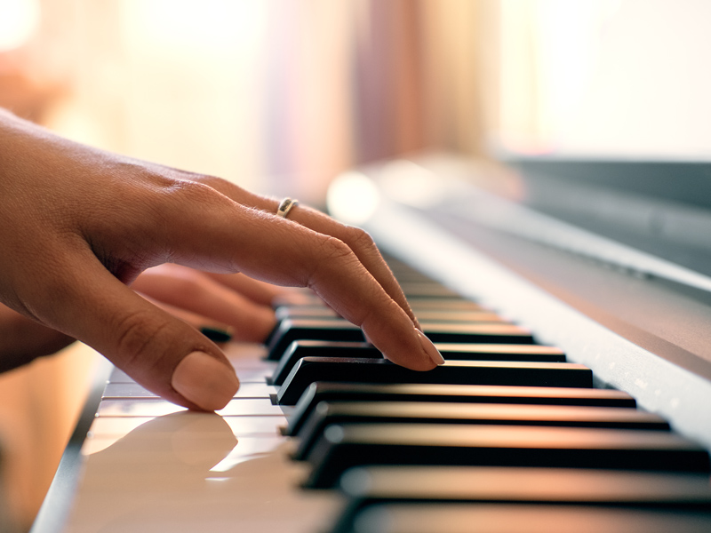 closeup of someone playing piano