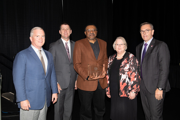 Board of Regents Chairman Tim Clare, President Emeritus Hank Bounds, 2019 ORCA Award Recipient Kwame Dawes, Ph.D. (UNL Chancellor's Professor of English & editor of Prairie Schooner), Interim President Susan Fritz and UNL Chancellor Ronnie Green at the 2019 President's Excellence Awards.