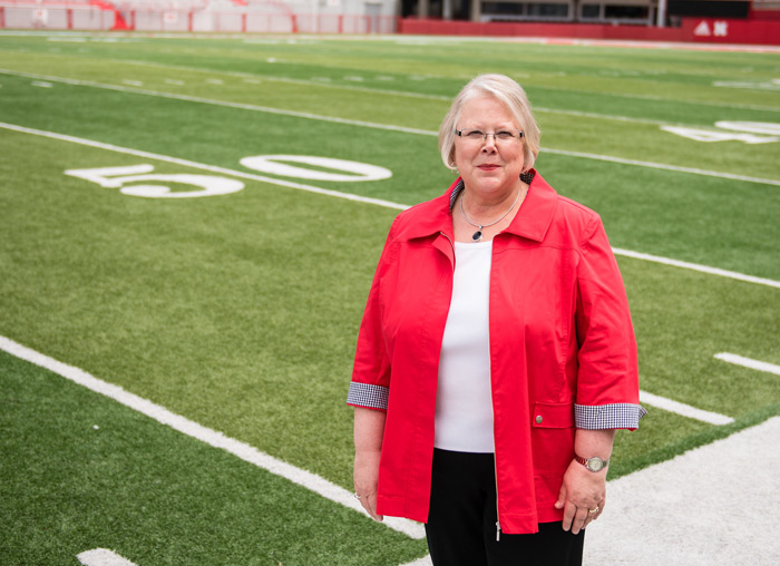 Dr. Susan Fritz on the 50-yard line at Memorial Stadium. She believes we should win on the field, in the classroom and lab, and in the community.