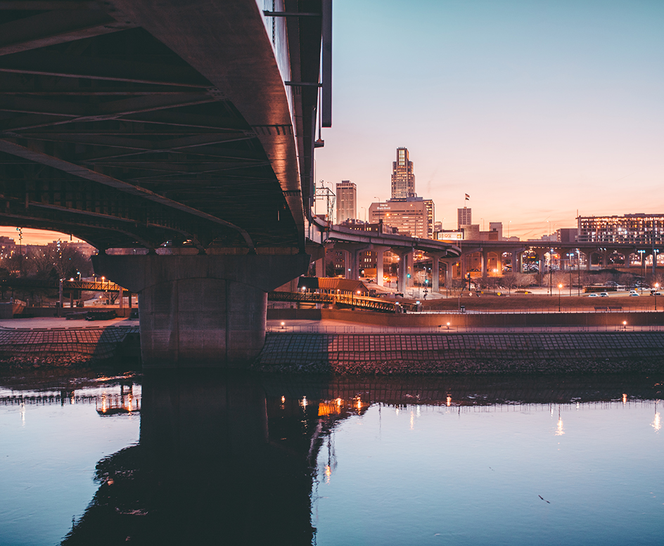Omaha skyline at sunset with bridge and water