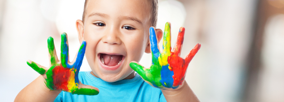 Excited child painting with their hands